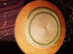 wood tbale with start of color rope